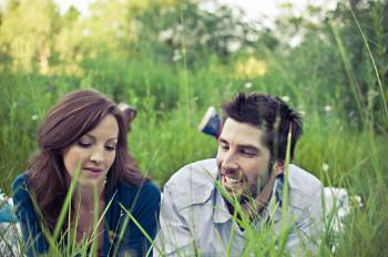 couple in a field talking