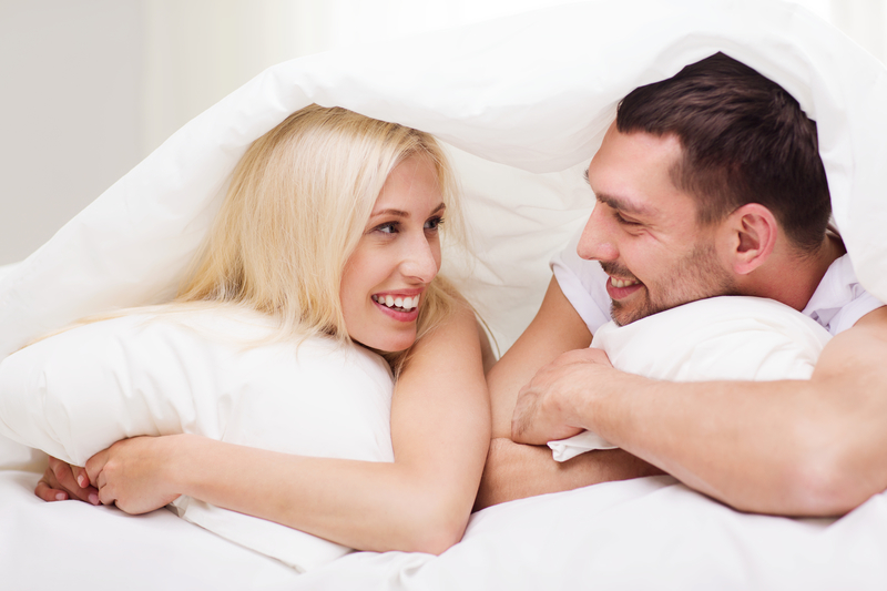 couple in a bed talking